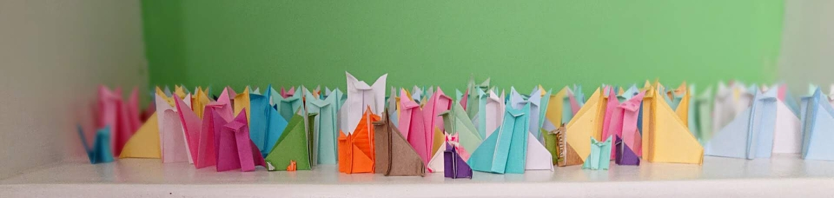 103 colourful origami paper foxes on a shelf