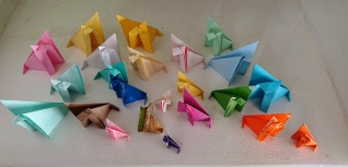 Different colours of origami/paper foxes