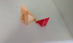 A red and a Cream origami paper fox