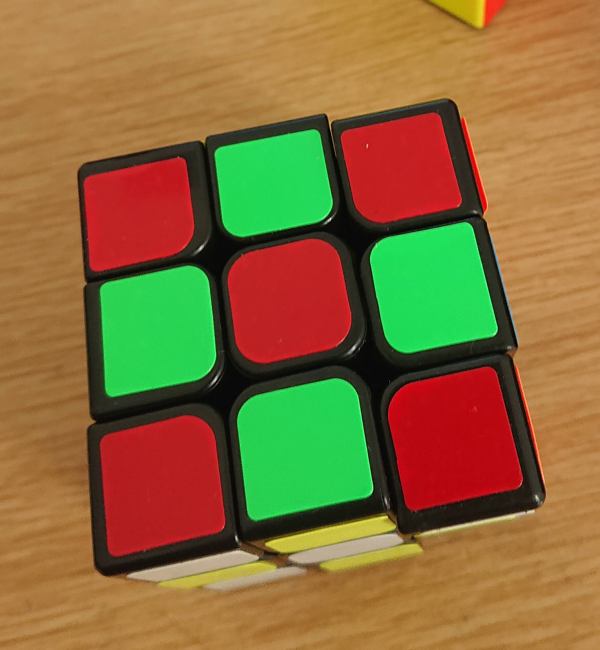 A wrongly coloured Rubiks cube in the flower pattern: red and green
